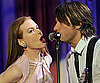 Slide Photo of Keith Urban and Nicole Kidman Singing Together in LA