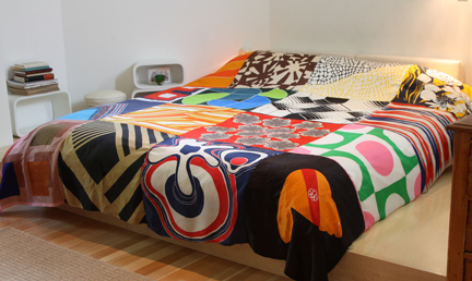 Ouno Design creates cool bedspreads out of vintage scarves. Gather vintage scarves and sew your own, if you have basic skills and a machine.