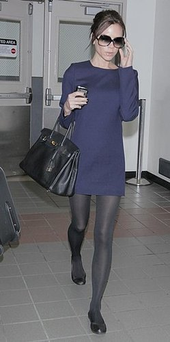 Victoria Beckham Wearing Flats and a Navy Dress at London Heathrow Airport 2010-01-25 13:00:22