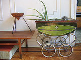 Try using unusual objects, like this vintage pram, as a planter.
