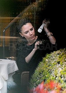 Photos of Victoria Beckham Reviewing Her New Dresses at a Restaurant in Milan