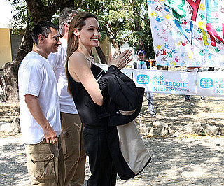 Slide Photo of Angelina Jolie Helping Kids in Haiti