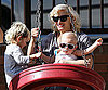 Slide Photo of Gwen Stefani Swinging with Kingston and Zuma