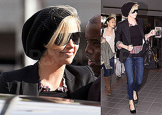 Photos of Charlize Theron Wearing Skinny Jeans and a Black Blazer and Hat at LAX
