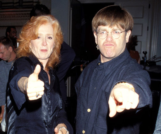With Elton John in 1997