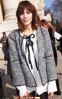 Alexa Chung Wearing Ribbon Shirt at Chanel Paris Fashion Week Show