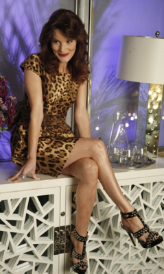 Sydney Andrews Wears Leopard Dress on Melrose Place