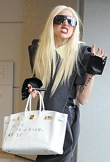 Lady Gaga Carries a White Graffitied Hermes Bag At Japan's Narita airport