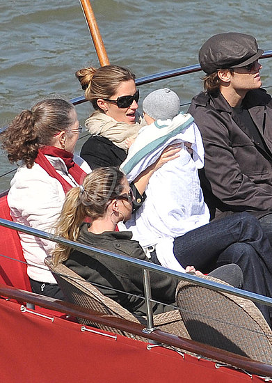 Gisele Bundchen wears a loose bun.