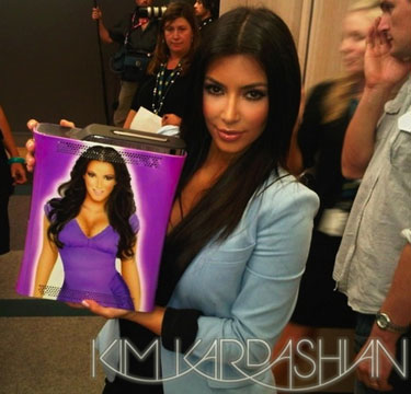 Kim Kardashian Paints Bikini Body on an Xbox 360