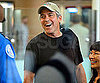 Slide Picture of George Clooney Leaving LAX With a Big Smile