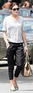 Olivia Palermo Wears Black Trousers and Gray T-Shirt in West Village