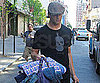 Slide Picture of Tom Brady Carrying Baby Supplies
