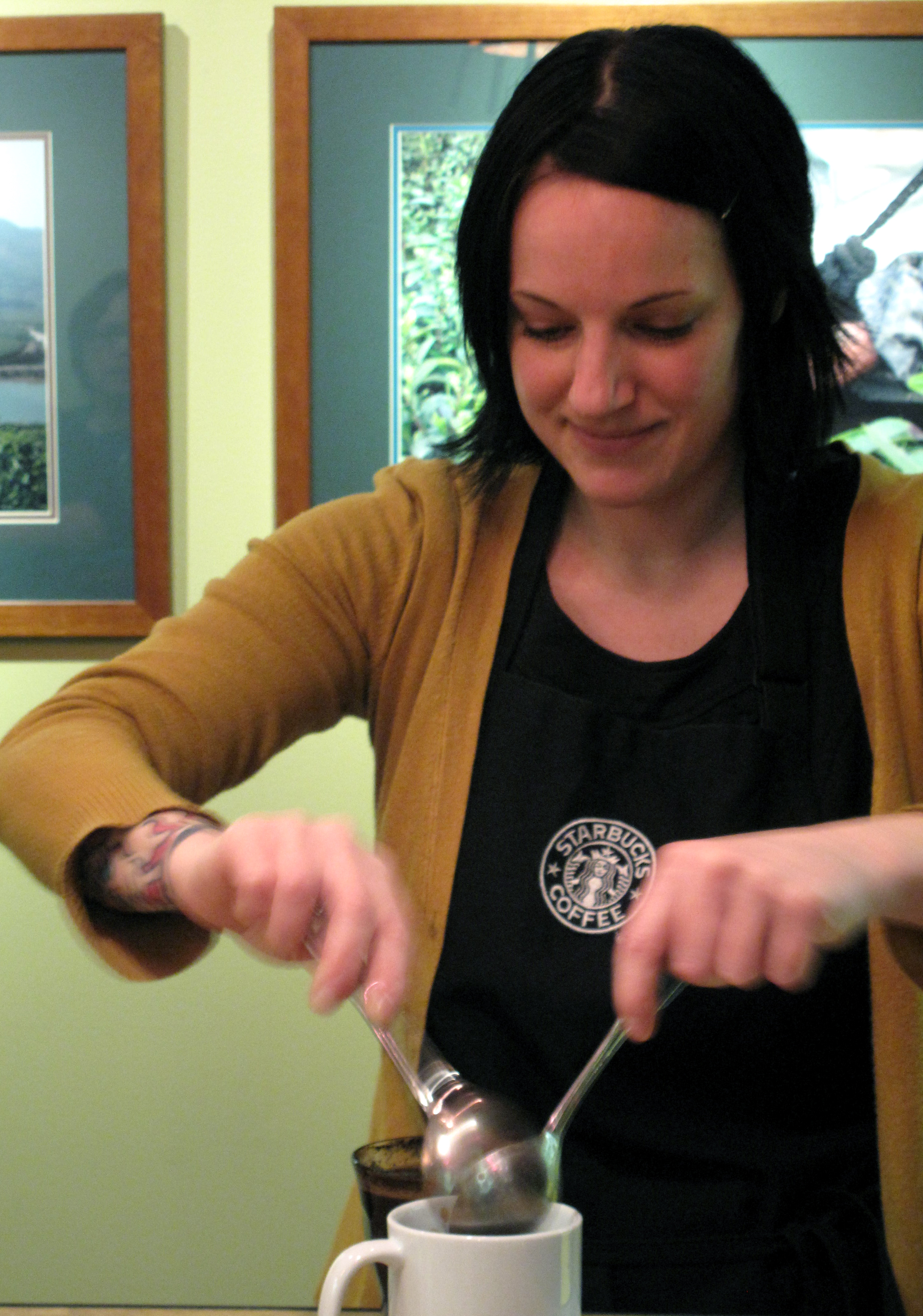 Starbucks's June Ashley demonstrating how to break the seal.
