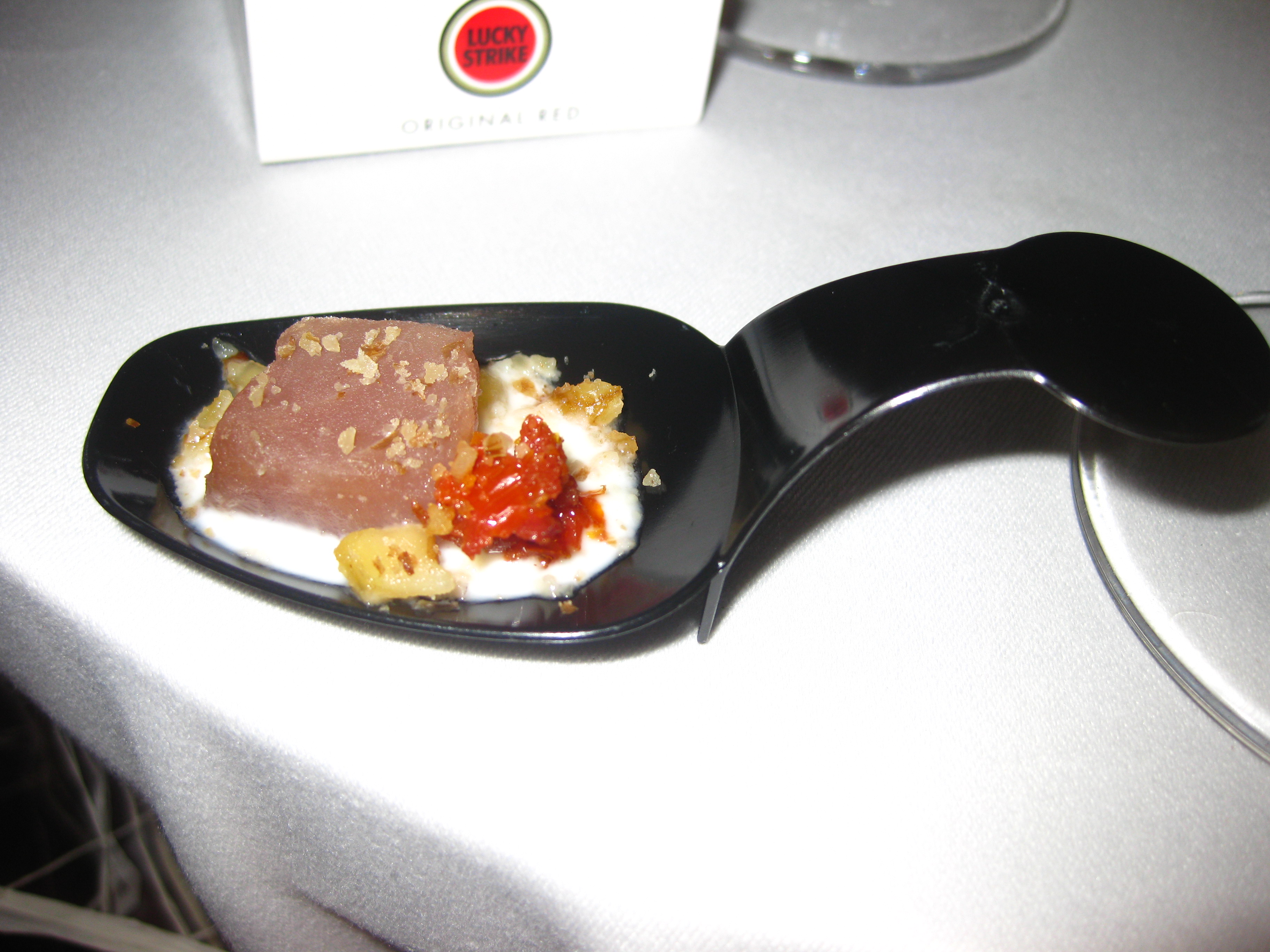 Naturally, I enjoyed all of the food. This marinated tuna bite was served with a foamy coconut sauce and confit of tomatoes.