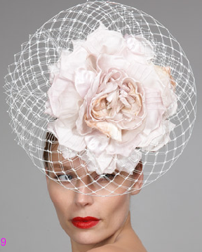 The oversized flower and net detail are just right for Gaga, especially since she loves to shield her face.