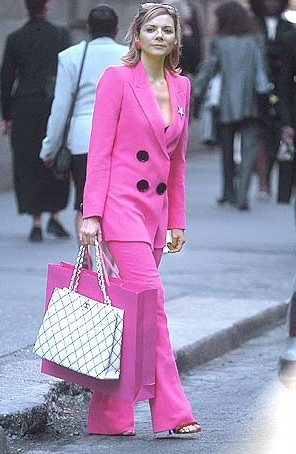 Samantha in a shocking pink Emanuel Ungaro pantsuit.