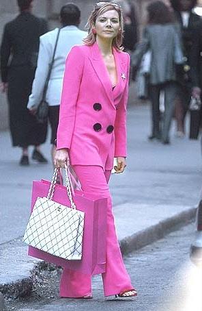 Samantha in a shocking pink Emanuel Ungaro pantsuit.