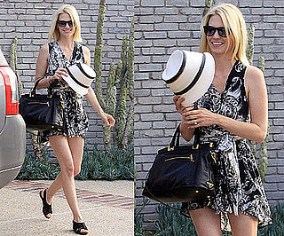 January Jones Wearing a Black and White Print Dress and Black Prada Bag