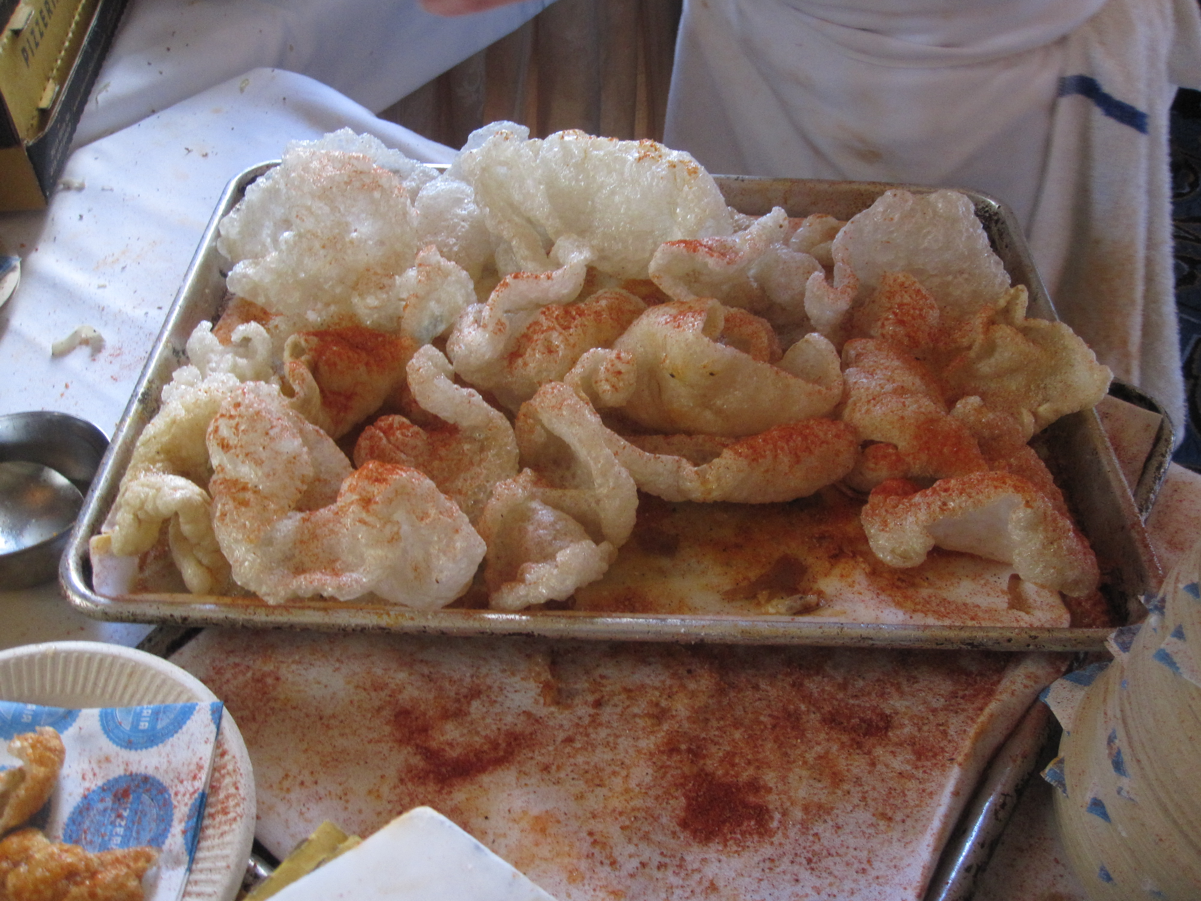 Chicharrones, or fried pork skin, at the Pizzeria Delfina table.