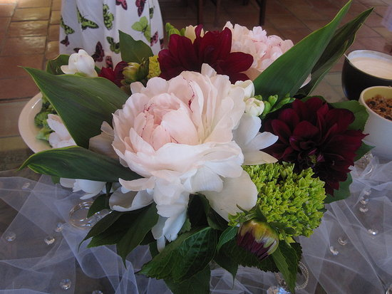 The bride's out-of-town friend sent several large bouquets of beautiful flowers.