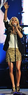 Carrie Underwood Wears Gold Skirt to Nashville Rising Concert