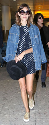 Alexa Chung Wears Polka Dot Dress and Supergas at Heathrow