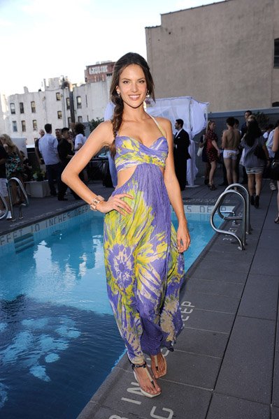 Alessandra Ambrosio is a vision of Summer in her cutout purple and yellow maxi and sexy side braid.