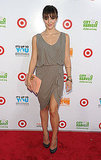 Katharine McPhee, in a perfectly draped Alice + Olivia dress and peach clutch.