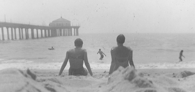1959 Chilling out (or whatever the 1950s equivalent was) on Manhattan Beach in California.  Source: Flickr User roberthuffstutter