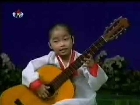 Amazing young girl playing the guitar!