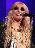 June 2010: Performing with her band The Pretty Reckless at a Nylon Party