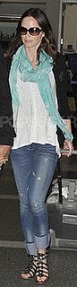 Emily Blunt Wears Jeans and Gladiator Sandals at LAX