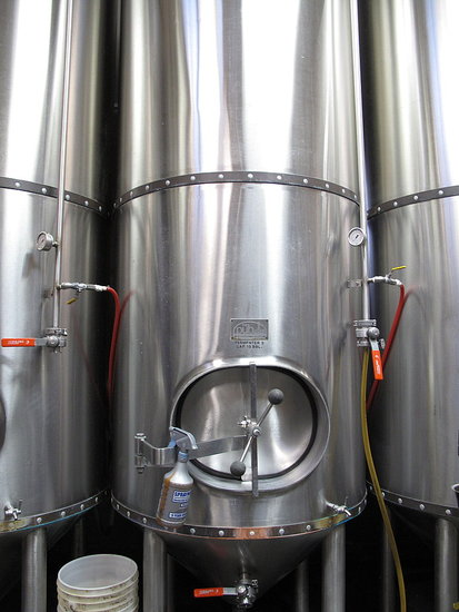 The brew sits in large fermenting tanks for over a week.