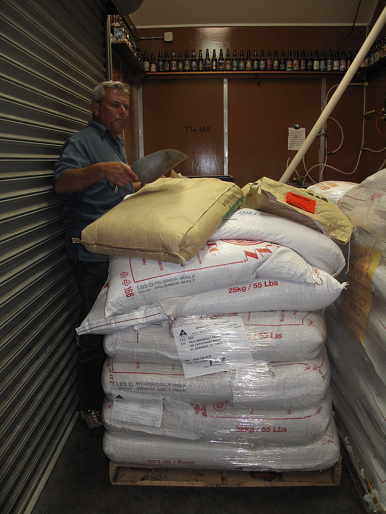 "Bags of ""malts,"" or malt barley, stacked high."