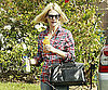 Slide Picture of January Jones Holding Lots of Juice in LA