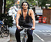 Slide Picture of Russell Brand Riding a Bike in NYC