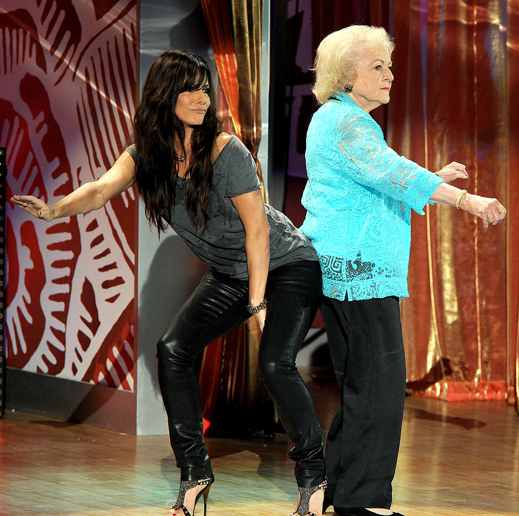 """Sandra Bullock (in J Brand """"912"""" jeans) and Betty White get down."""