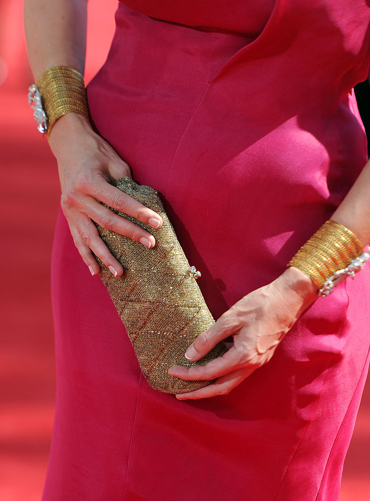 Julia Ormond's fuchsia gown was given a Midas touch thanks to gold accessories.