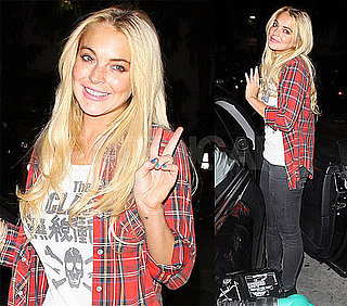Pictures of Lindsay Lohan Flashing a Peace Sign at a Gas Station in LA