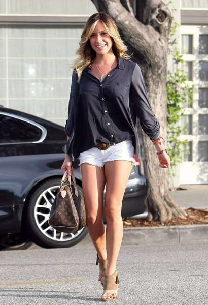 Kristin Cavallari channeled Farrah Fawcett in Black Orchid white denim shorts, a loose-fitting blouse, and gorgeous waves. Get her look now.