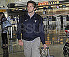 Slide Picture of Bradley Cooper at an Airport