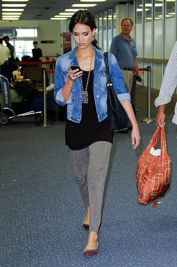 On her way to Italy for the Venice Film Festival. Notice she's wearing the same necklace as her all-black ensemble.