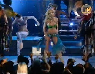 "Watch Britney Spears's 2001 MTV VMA Performance of ""I'm a Slave 4 U"""