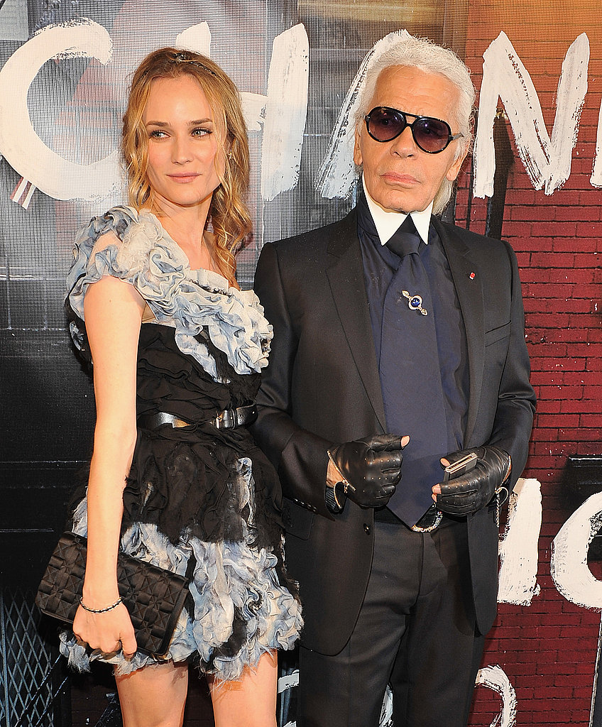 The dynamic fashion duo: Diane Kruger, in a ruffled confection from Chanel Fall '10, strikes a pose with Karl.