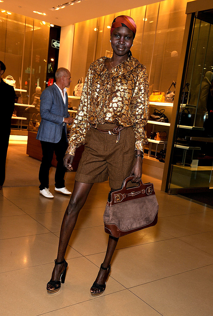 Alek Wek glows in glittery gold at Salvatore Ferragamo in NYC.