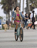 Model Caroline D'Amore was California cool in her fuchsia bikini and denim jacket while taking a bike ride in Santa Monica.