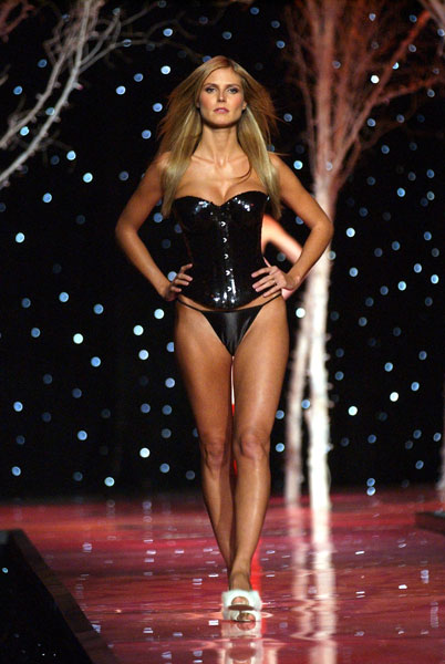 Heidi strutting her hot stuff in a black corset in 2001.