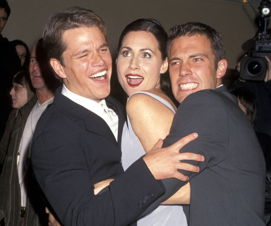 Costars Matt Damon, Minnie Driver, and Ben Affleck cuddled close in December 1997.