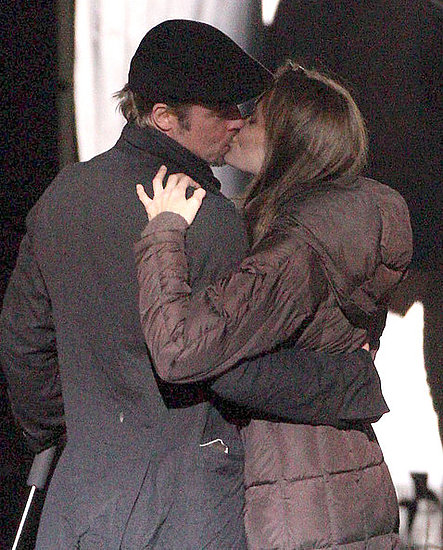 Angelina Jolie and Brad Pitt kiss On set